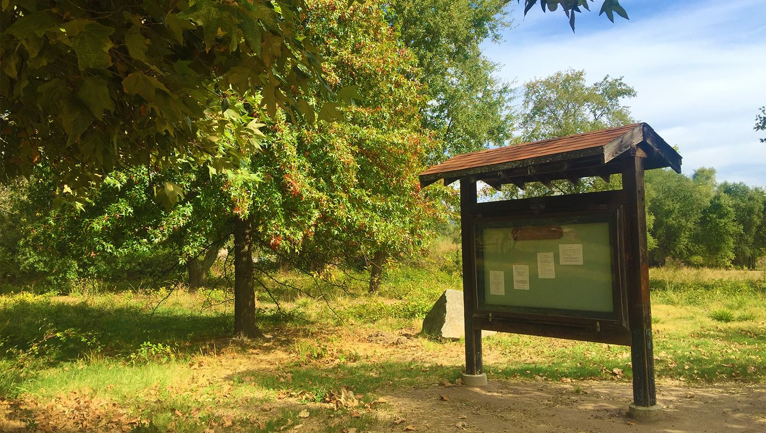 Photograph of a kiosk and foliage at Traylor Ranch