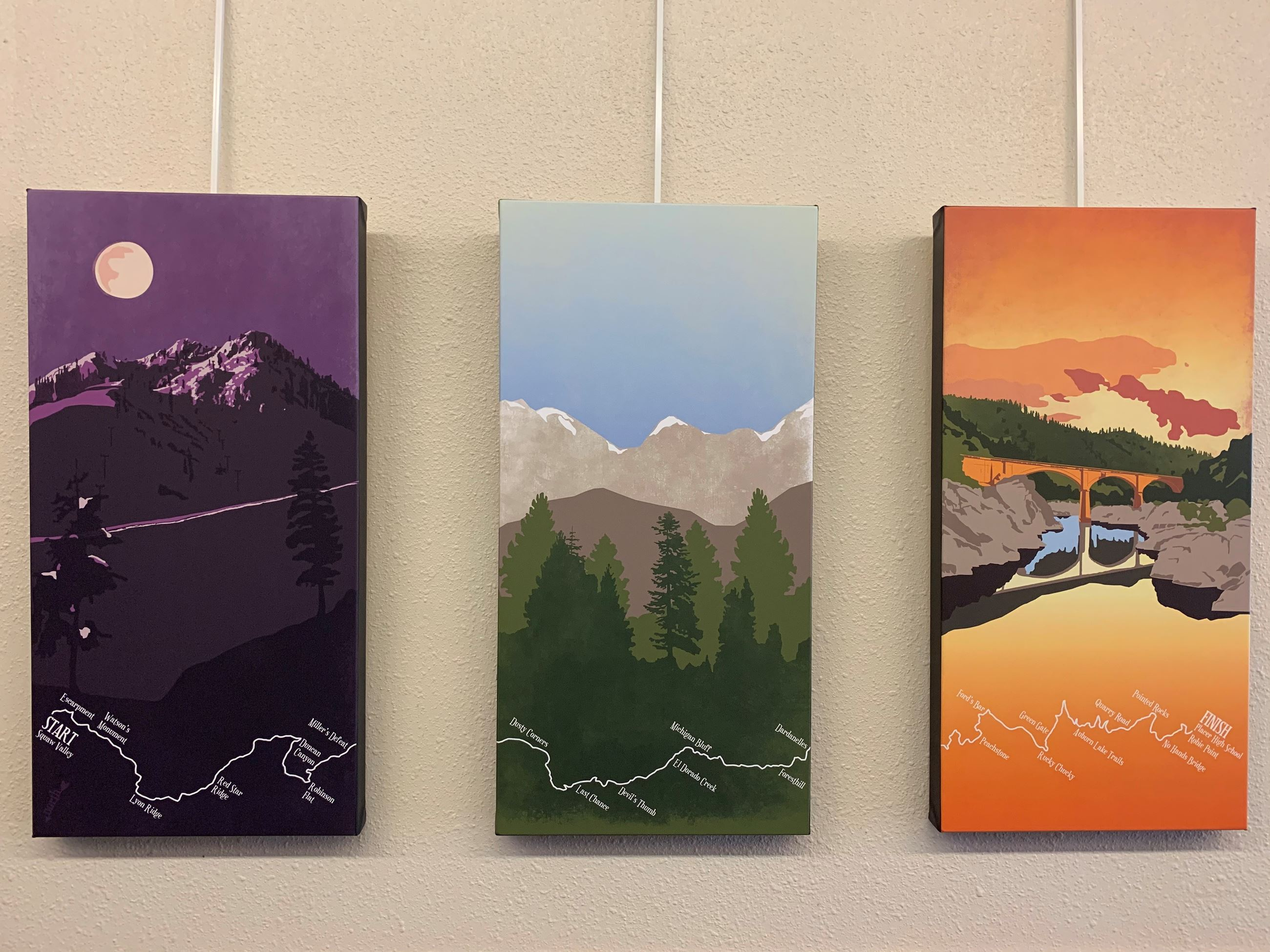 series of three painting hanging on a wall. paintings of mountains.